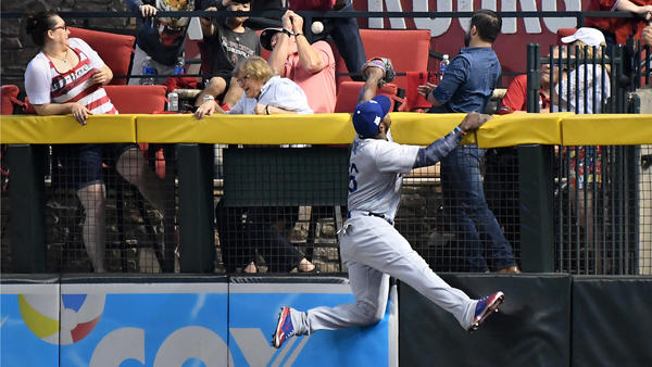 Yasiel Puig can't reach a home run hit by Daniel Descalso. (Wally Skalij / Los Angeles Times)
