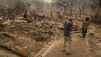 At least 10 dead, 1,500 structures lost in Northern California firestorm, among worst in state's history