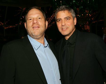 Harvey Weinstein and George Clooney attend the National Board of Review of Motion Pictures Awards reception in 2006. (Evan Agostini / Getty Images)