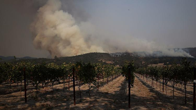 An wildfire approaches a Sonoma winery Oct. 9. (Justin Sullivan / Getty Images)