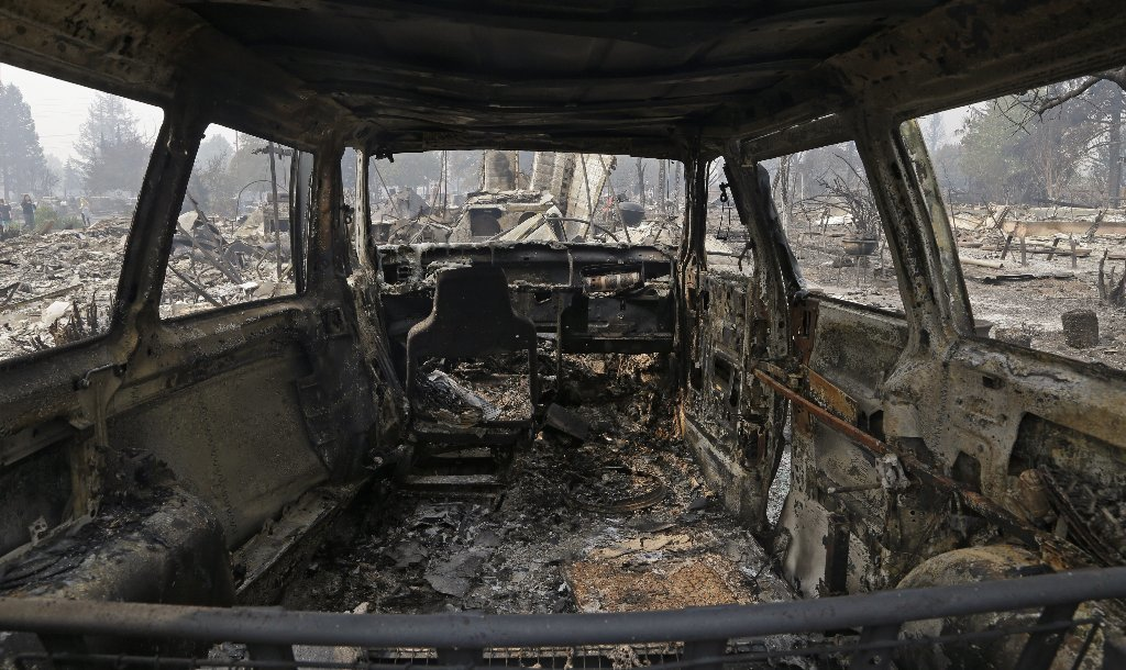 View from inside a parked car destroyed by fire in the Coffey Park area of Santa Rosa, Calif., on Tuesday, Oct. 10, 2017.