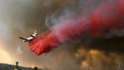 24 structures lost and 7,500 acres burned in Orange County firestorm, but progress reported