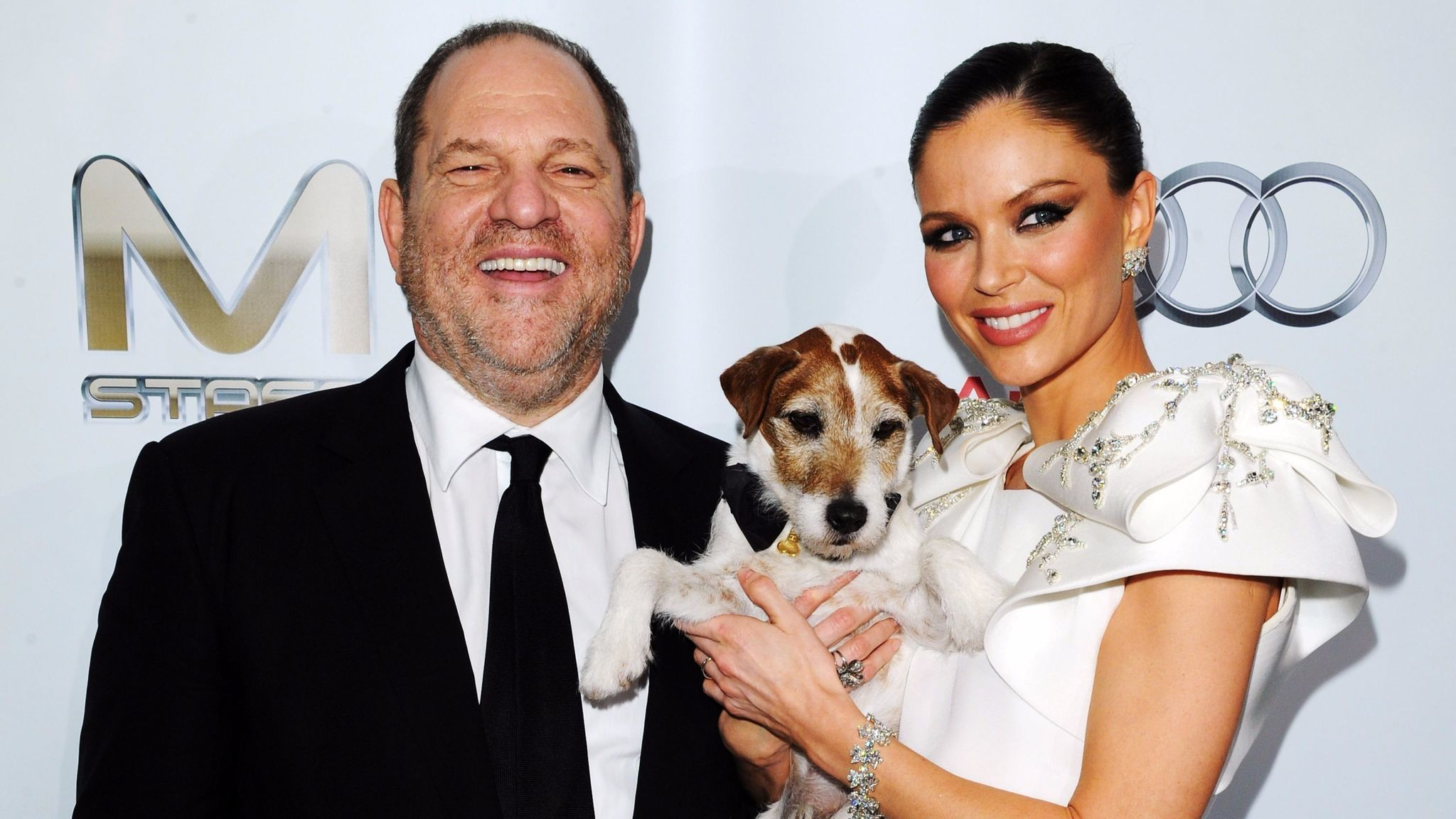 Harvey Weinstein, Uggie the dog and Georgina Chapman attend Weinstein Co.'s Oscar after-party at SkyBar at the Mondrian Los Angeles on Feb. 26, 2012 in West Hollywood.
