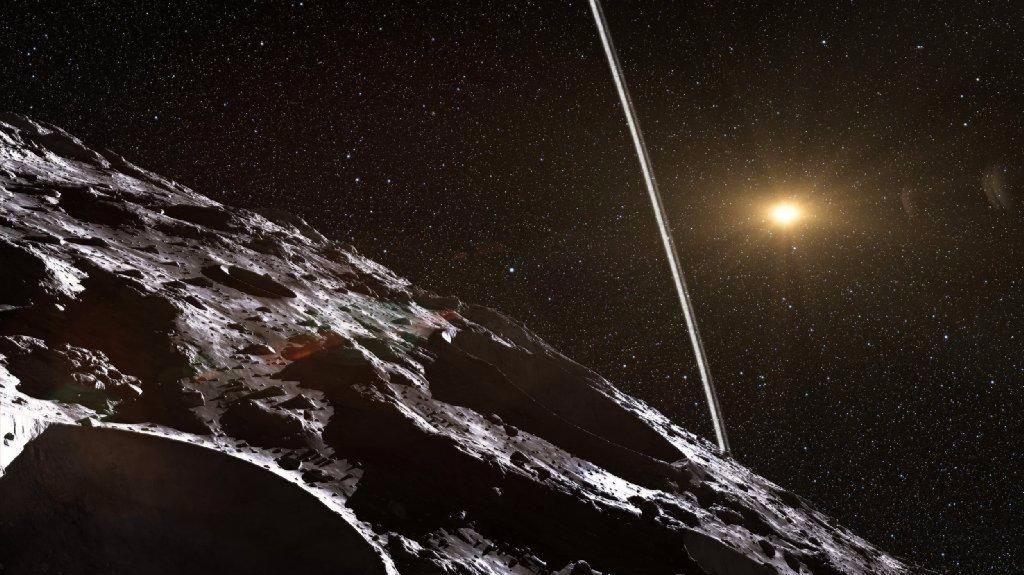 An artist's impression illustrates how the rings surrounding the comet-asteroid hybrid Chariklo might look from its surface.