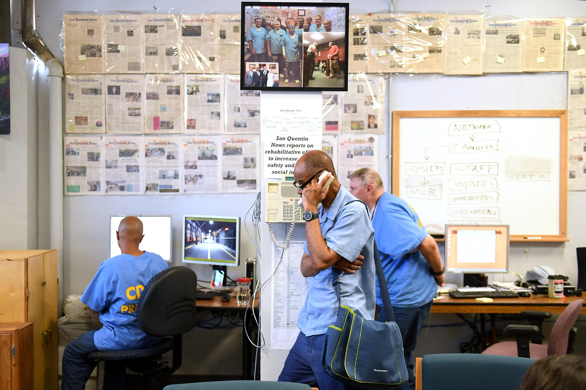 The staff at work in the newsroom of the San Quentin News.