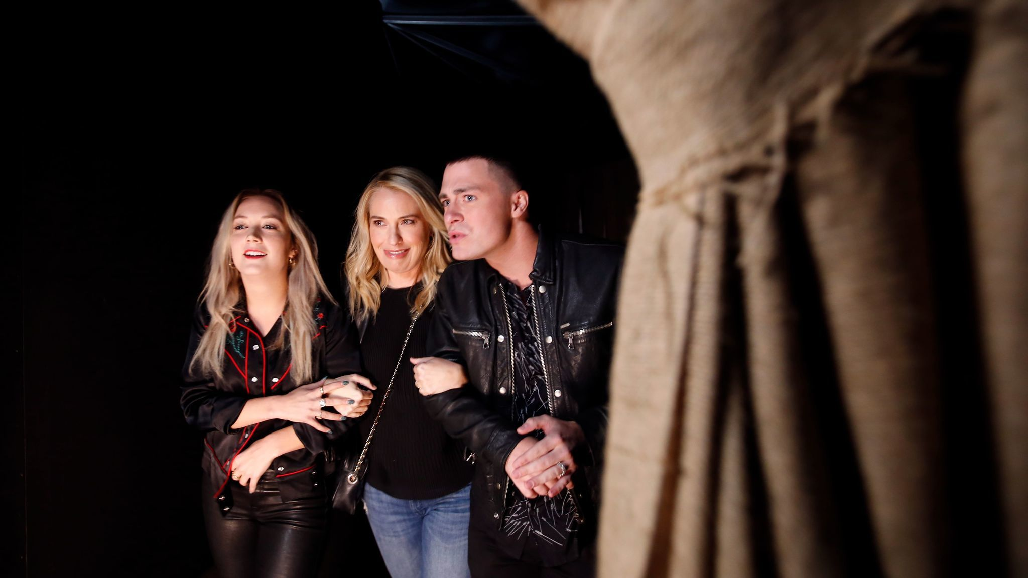 "Cast members of FX's ""American Horror Story: Roanoke,"" from left, Billie Lourd, Leslie Grossman and Colton Haynes get spooked in the Universal Studios maze based on their TV show. (Francine Orr / Los Angeles Times)"