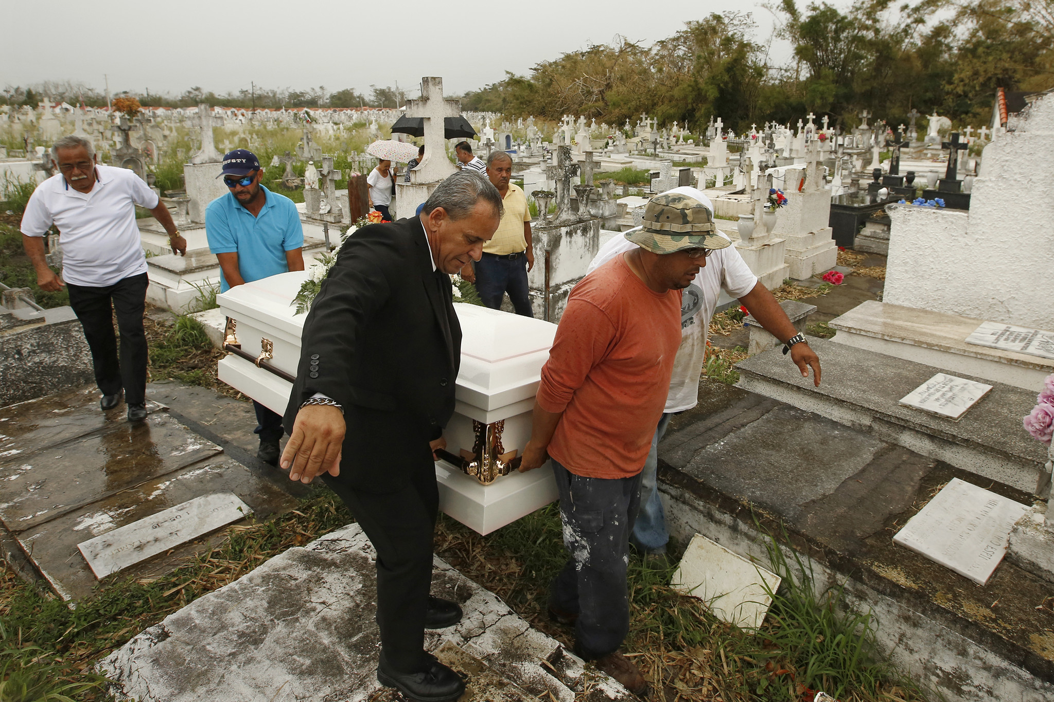 The casket of Norma Casiano Rivera is carried to her grave at the Lajas municipal cemetery.