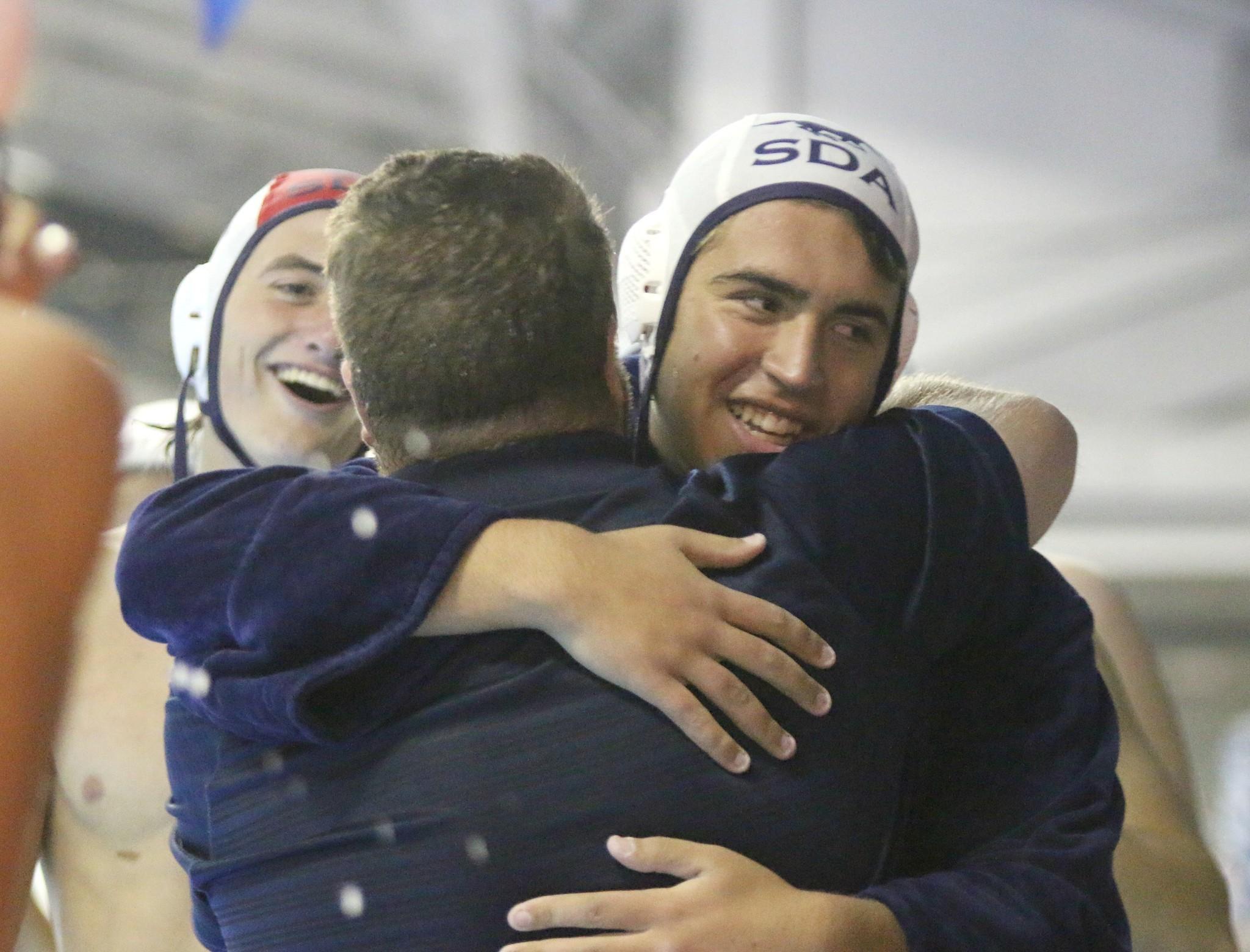 Matheus Gensler receives a congratulatory hug.