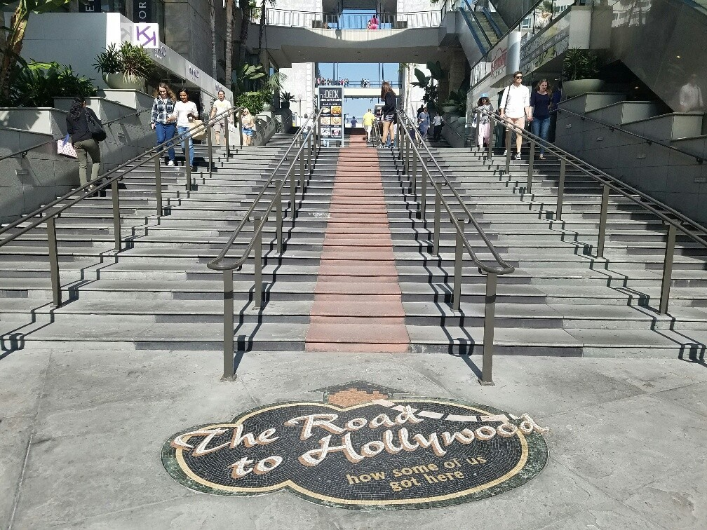 """The Road to Hollywood"" begins on Hollywood Boulevard, then climbs the stair in a red-cement ""carpet."""