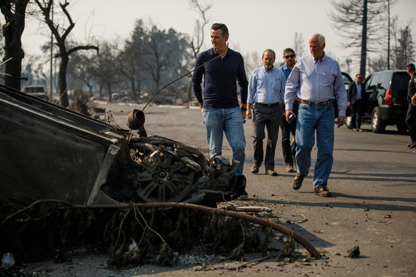 Lt. Gov. Gavin Newsom, from left, Santa Rosa Mayor Chris Coursey and Congressman Mike Thompson survey fire damage. (Marcus Yam / Los Angeles Times)