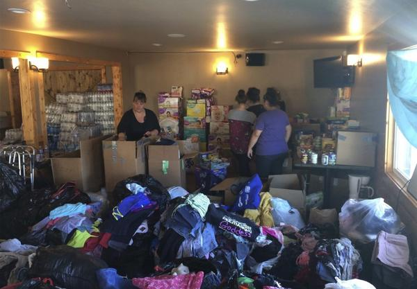 Redwood Valley residents sort through donations and supplies at McCarty's Bar, which turned into an evacuation center in Redwood Valley, Calif. on Saturday, Oct. 14. (Paul Elias/AP)