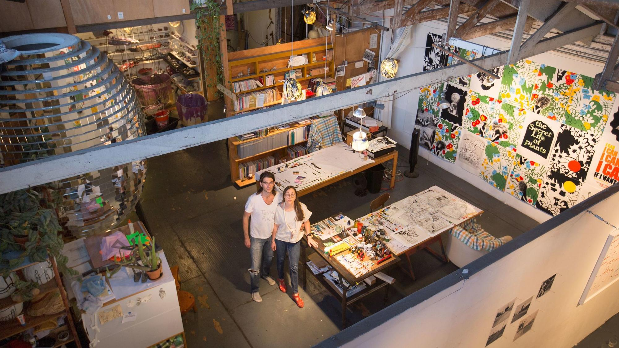Artists Michael Parker and Alyse Emdur at their Artists' Loft Museum, a show in their studio loft that brings together the work of artists who have passed through their space.