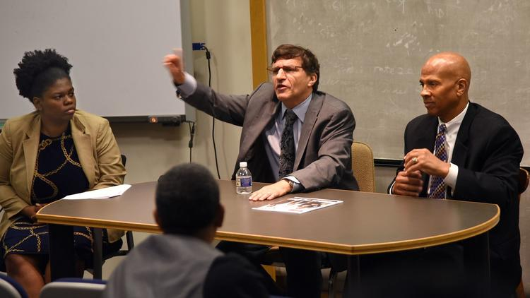 Law professor Michael Meyerson, center, speaks to students at Morgan State University. Other panelis