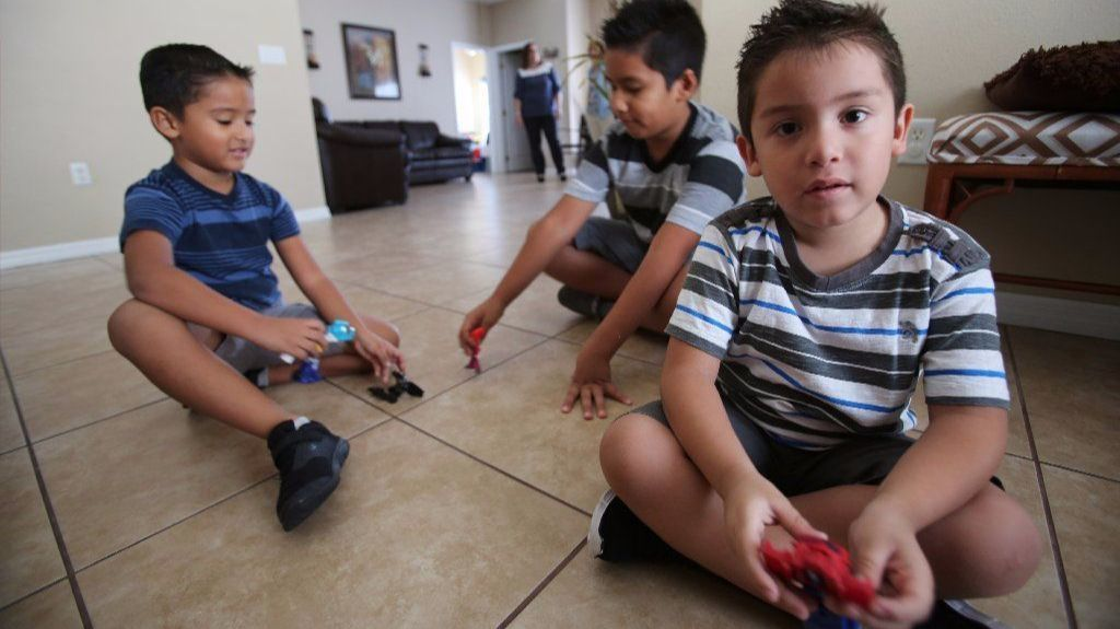 Jonathan, 5; Ryan, 9;  and Jahdiel Ramos, 5, play as their mom Edda Melendez watches, at their Kissimmee home.