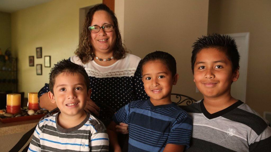 Edda Melendez and her three boys, left to right, twins Jahdiel and Jonathan, 5; and older brother Ryan Ramos, 9, at their Kissimmee home.