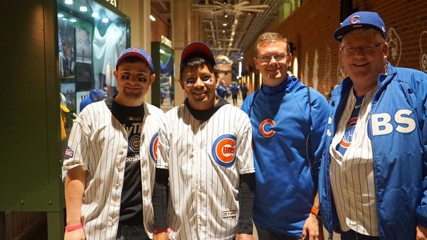 Friends and Cubs fans Blake Taylor, Ben Reyes, Bob Laramie and Ken Brown (Hailey Branson-Potts / Los Angeles Times)