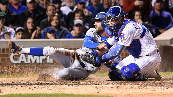 Chris Taylor is tagged out a the plate by Cubs catcher Wilson Contreras. (Wally Skalij / Los Angeles Times)