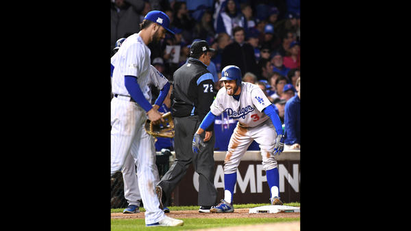 Chris Taylor sticks his tongue out as he celebrates his RBI triple. (Wally Skalij / Los Angeles Times)