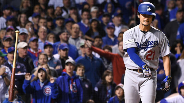 Yu Darvish tosses his bat after walking with the bases loaded. (Wally Skalij / Los Angeles Times)