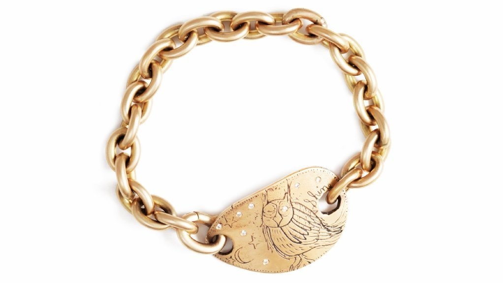 "Jes MaHarry's 14-karat yellow gold wise owl ""Good Times"" bracelet."