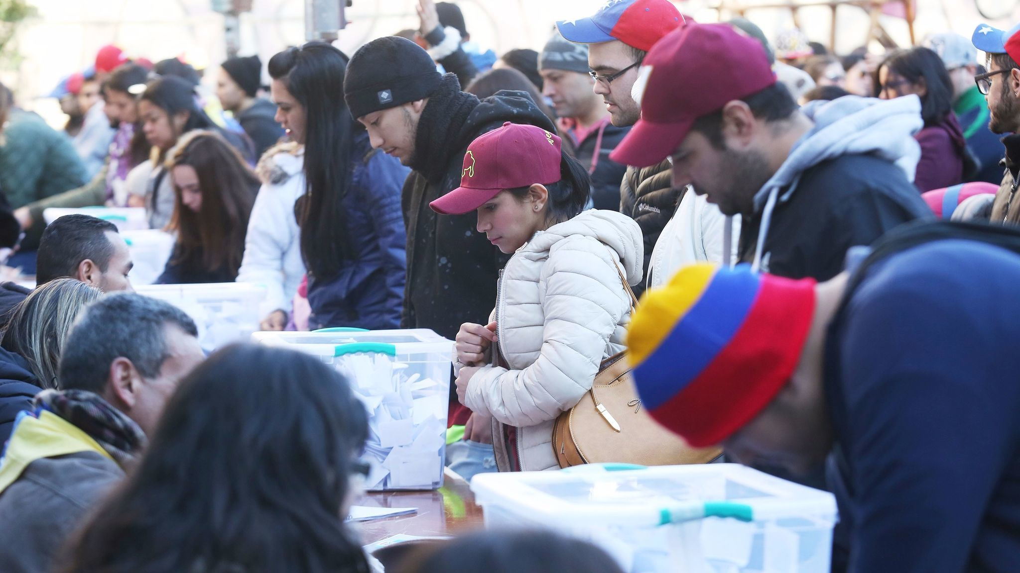 Venezuelans in Santiago, Chile, assembled in July to vote on an unofficial referendum to express their views on a plan by President Nicolas Maduro to rewrite the Venezuelan constitution.