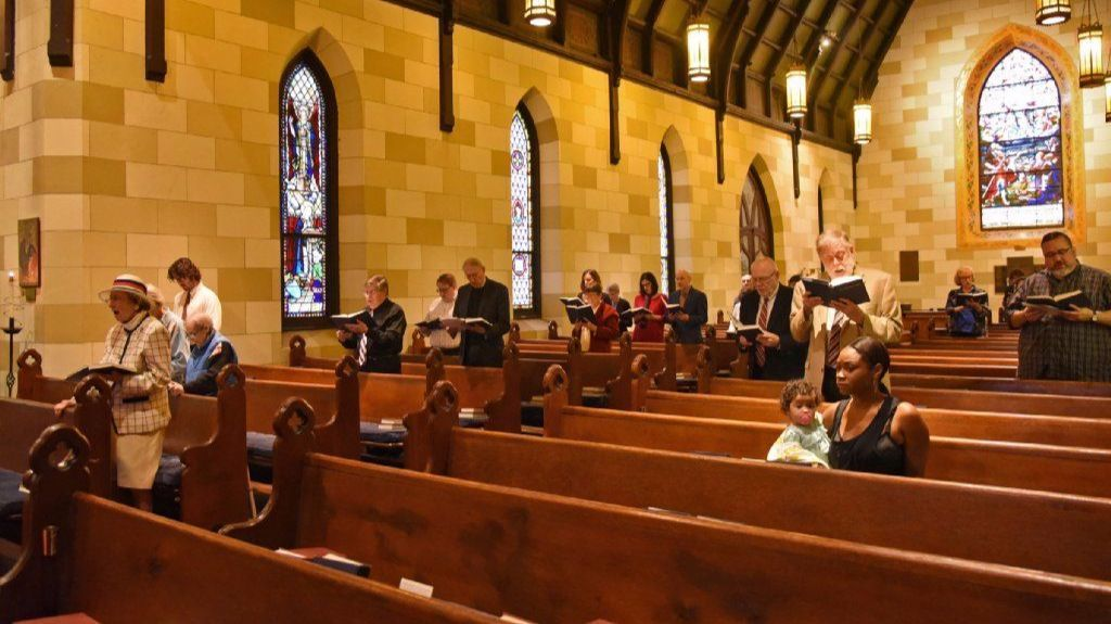 Worshippers at the 10:30 am service at St. John's Episcopal Church in the Village. The congregation and the community, are fighting the proposed closure by the Episcopal Diocese of Maryland, due to finances and declining attendance.