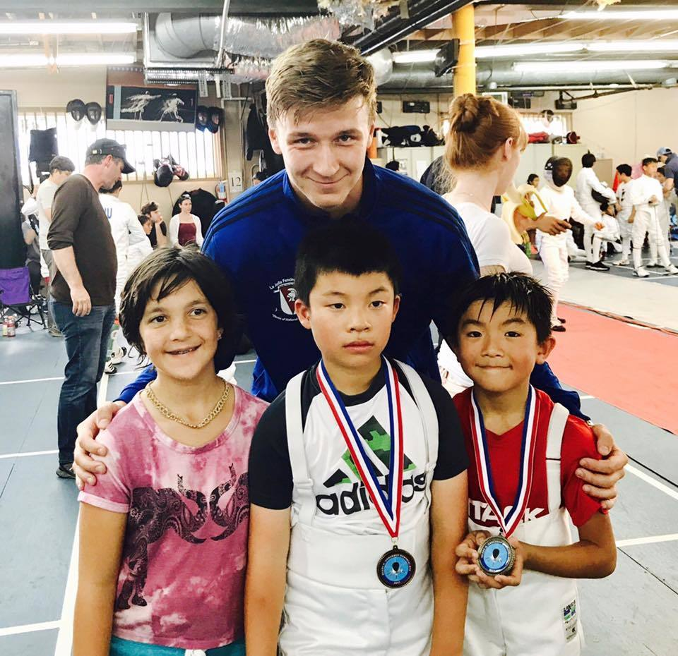 Coach Roman Sydorenko with La Jolla Fencing Academy champions.