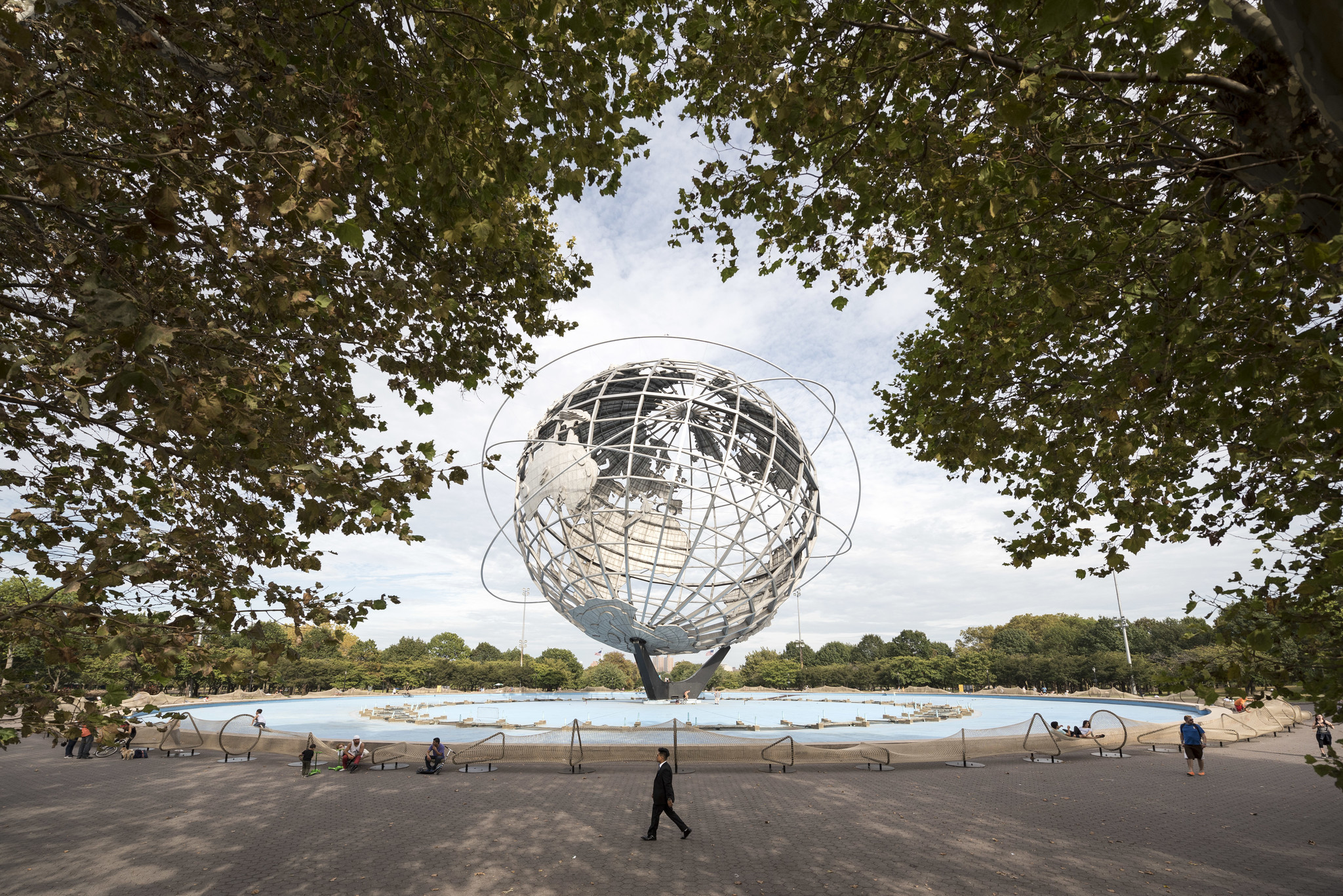 """Circle Fence"" is a low-lying rope barrier that surrounds the Unisphere, a depiction of the Earth made for the 1964 World's Fair."