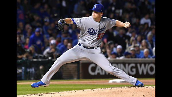 Alex Wood throws in the first inning. (Wally Skalij / Los Angeles Times)