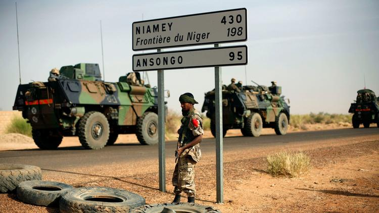 French armored vehicles head toward the Niger border in 2013. (Jerome Delay / Associated Press)