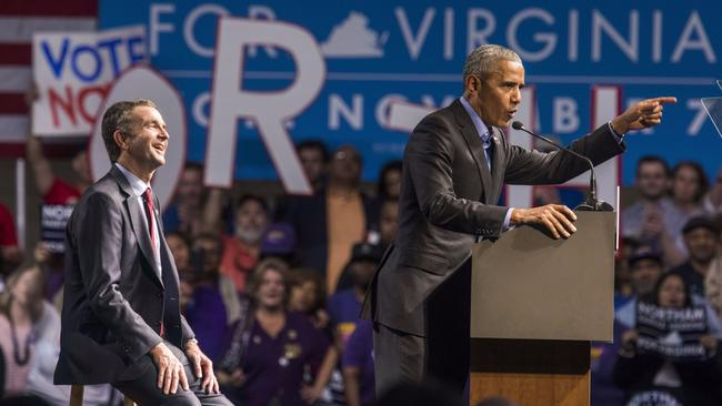 As Virginia Lt. Gov. Ralph Northam looks on, former President Obama speaks in Richmond, Va. (European Pressphoto Agency)