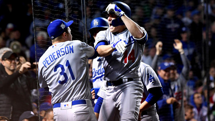 Enrique Hernandez celebrates his grand slam. (Wally Skalij / Los Angeles Times)