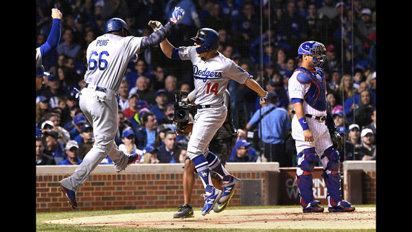 Dodgers Kiki Hernandez celebrates his grand slam with Yasiel Puig. (Wally Skalij / Los Angeles Tiems)