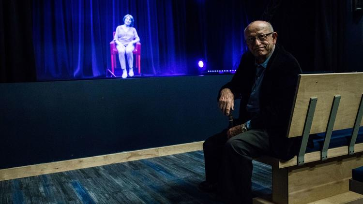 Holocaust survivor Sam Harris looks at a holographic image of Holocaust survivor Fritzie Fritzshall