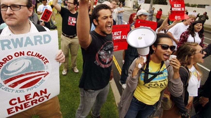 Aura Vasquez, with megaphone, leads chants during a 2013 march on L.A.'s Westside protesting the Keystone XL pipeline.