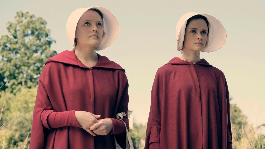"""Elisabeth Moss stars as Offred and Alexis Bledel as Ofglen in """"The Handmaid's Tale, """" a series based on a novel by Margaret Atwood about a dystopian future"""