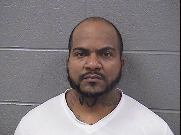 Evanston police: Man had live surveillance running when guns drugs found at his home