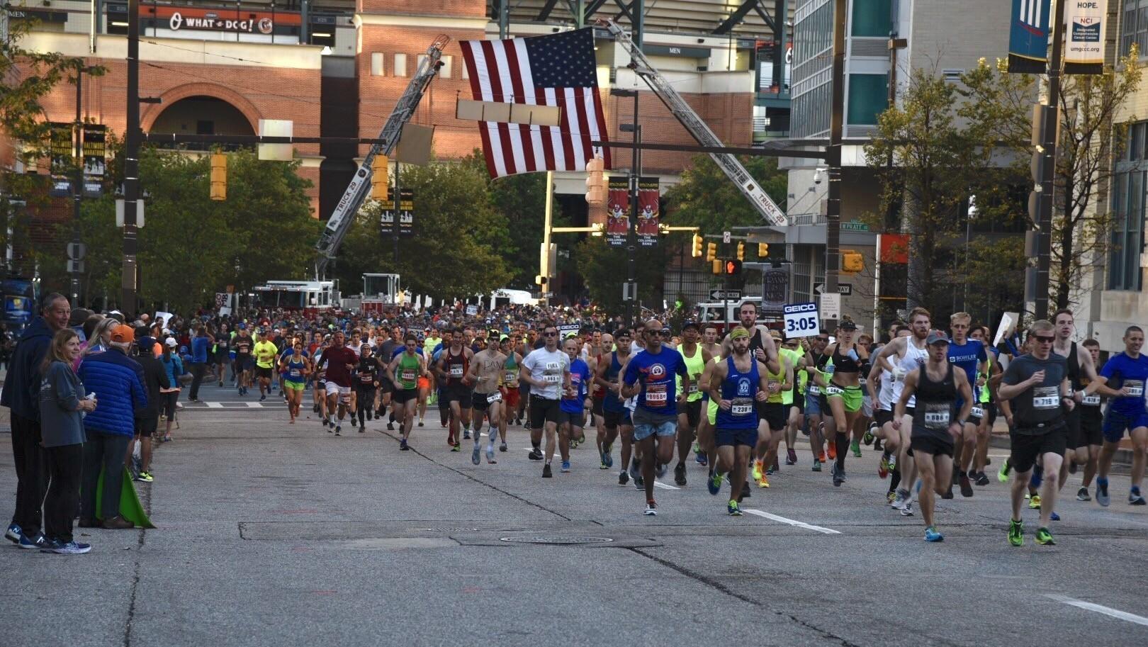 Former Navy cross country runner, Hopkins medical student Jordan Tropf wins Baltimore Marathon
