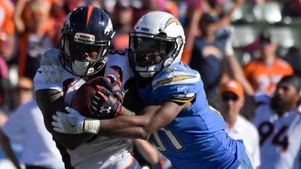 Denver Broncos wide receiver Demaryius Thomas, left, is tackled by Chargers strong safety Adrian Phillips during the second half. (Mark J. Terrill / Associated Press)