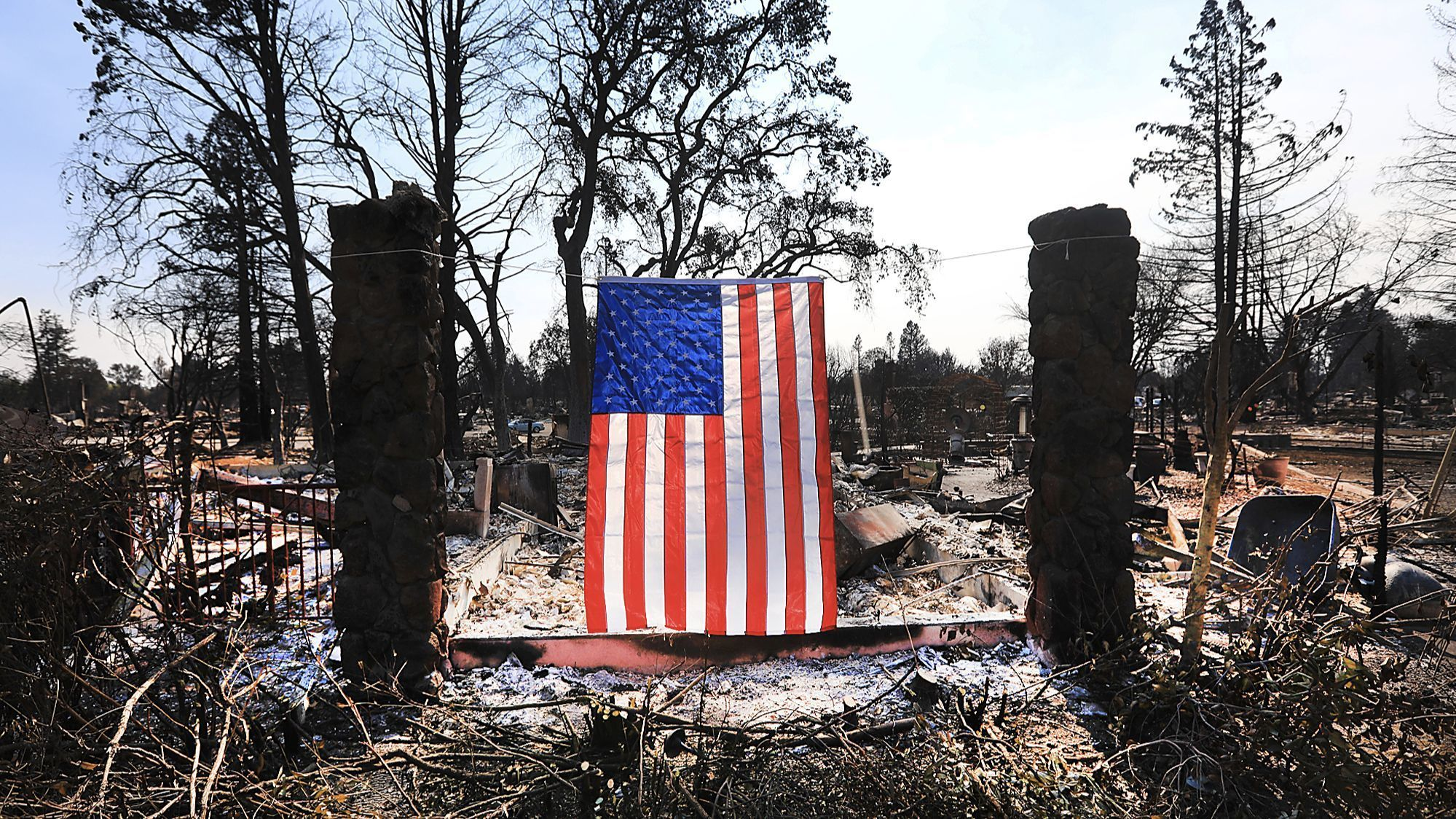 On Willowview Court in Santa Rosa, a homeowner displays an American flag amidst the destruction from the wildfire.