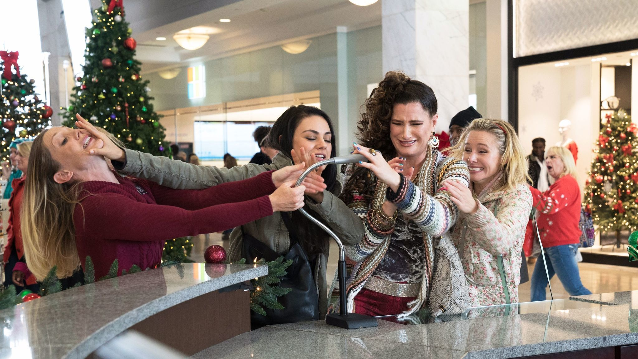 "Mila Kunis, center, Kathryn Hahn and Kristen Bell in a scene from ""Bad Moms 2."""