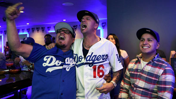 Friends Rick Ortiz, left, Ricardo Jaquez and Marco Villa cheer in the Gold Room during Game 2. (Michael Owen Baker / For The Times)