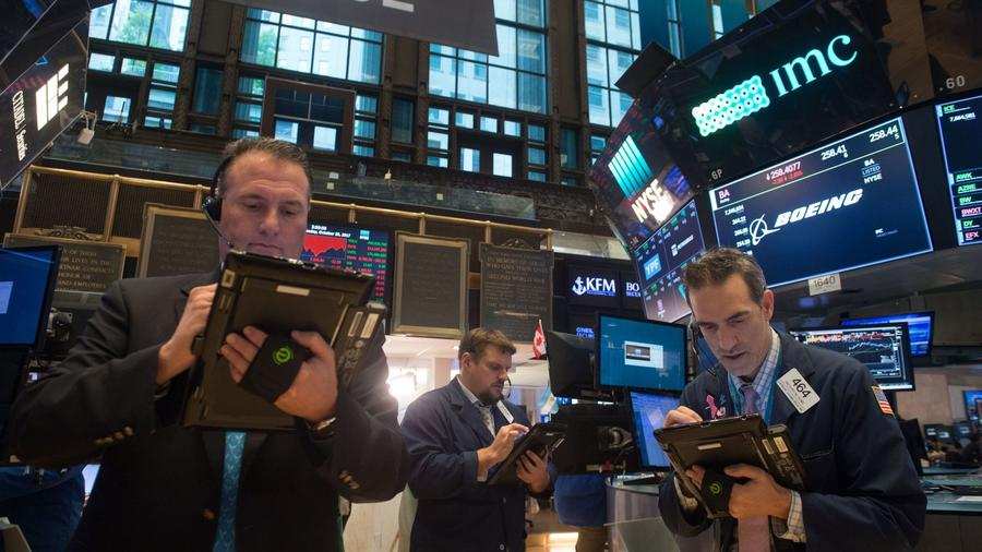 The traders on the floor of the New York Stock Exchange.