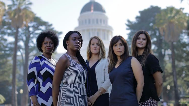 Tina McKinnor, left, Sadalia King, Amy Thoma Tan, Jodi Hicks and Sabrina Lockhart have come forward to talk about their experiences with sexual harassment at the Capitol. (Myung J. Chun / Los Angeles Times)