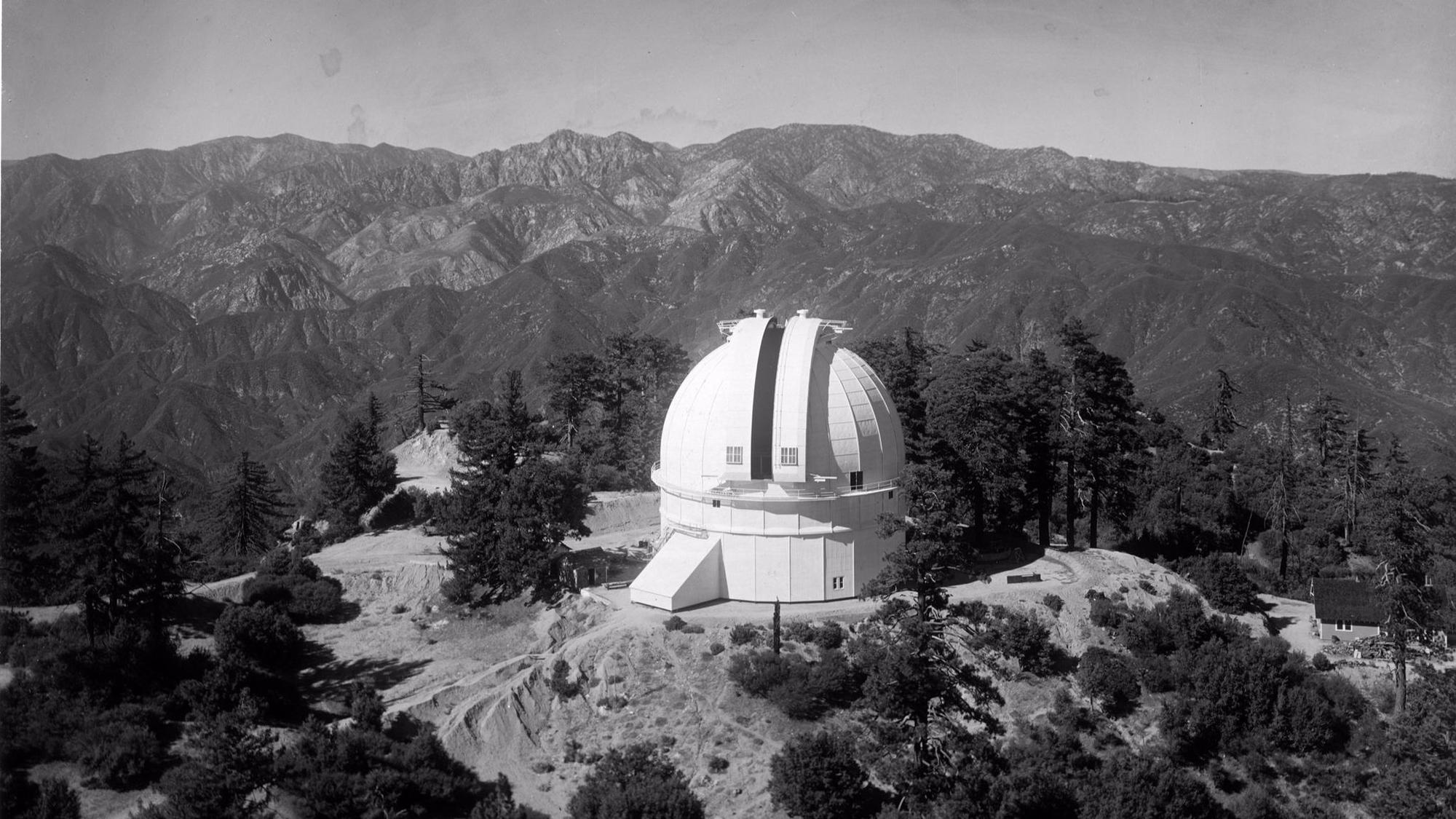 The completed 100-inch telescope dome at Mt. Wilson Observatory, as seen from the 150-foot tower telescope in 1916.