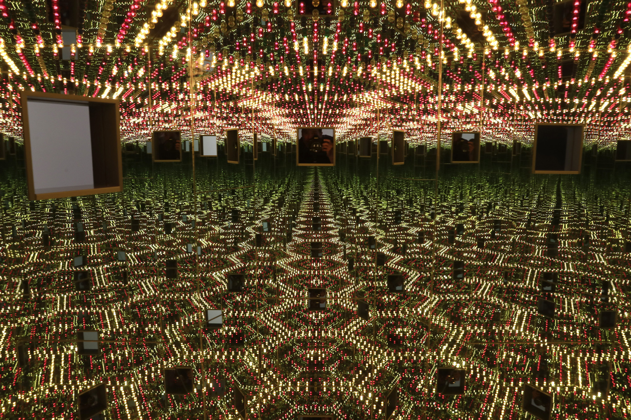 """Kusama's """"Infinity Mirrored Room — Love Forever,"""" with twin peep holes to look at the changing lights inside."""