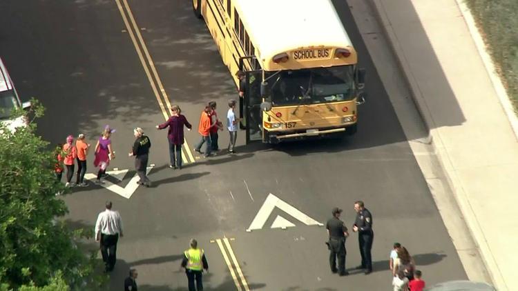 Raw: Man takes teacher hostage, barricades self inside classroom at Riverside elementary school