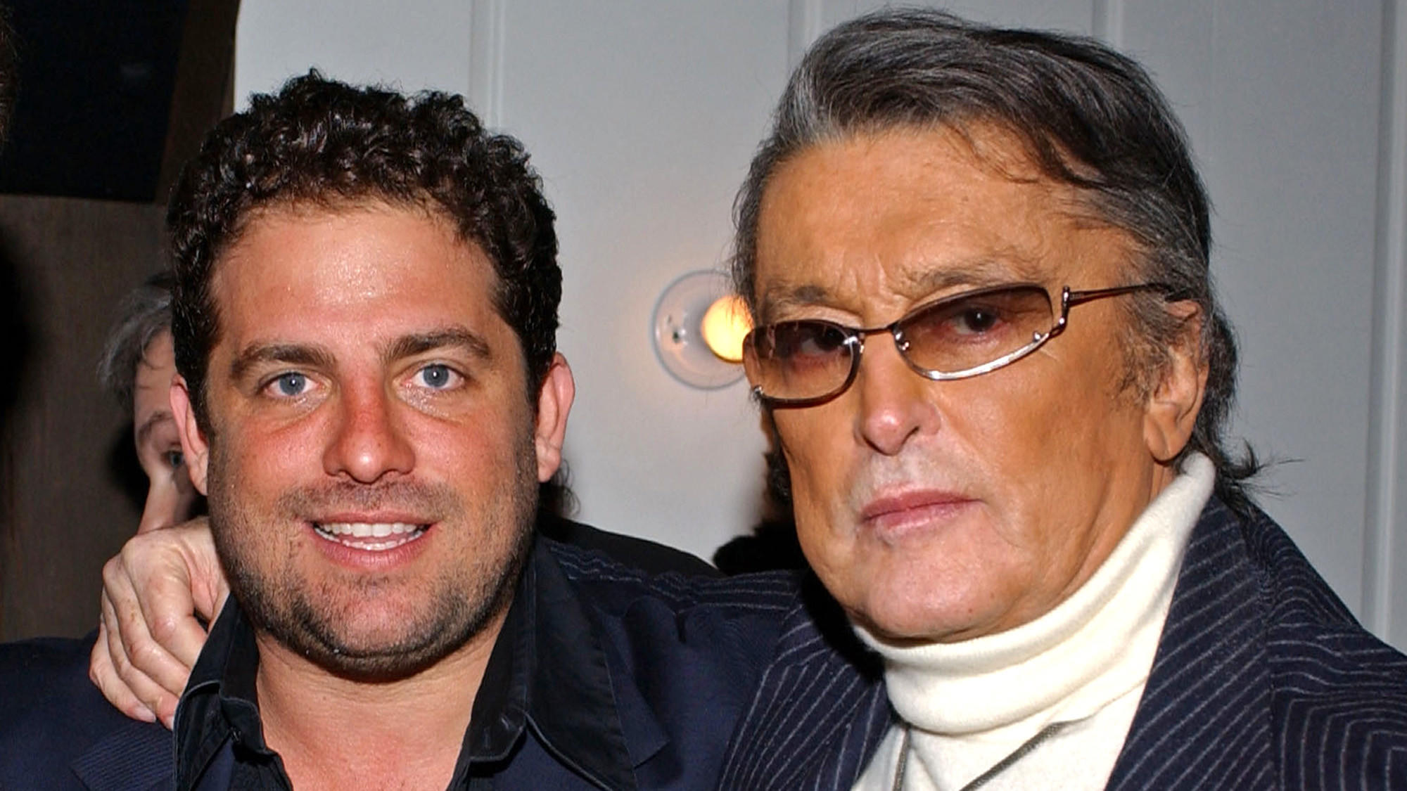 Director Brett Ratner and producer Robert Evans stand for a photo at a Beverly Hills Oscars party in 2005.