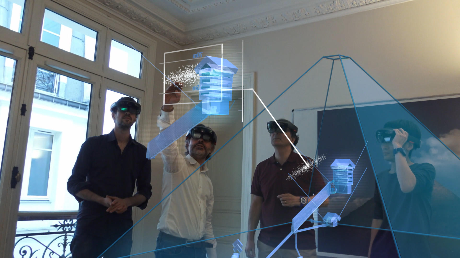 Members of the research team use augmented reality to visualize the pyramid's void.