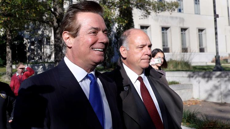 Paul Manafort, left, leaves the federal courthouse in Washington last month. (Alex Brandon / Associated Press)